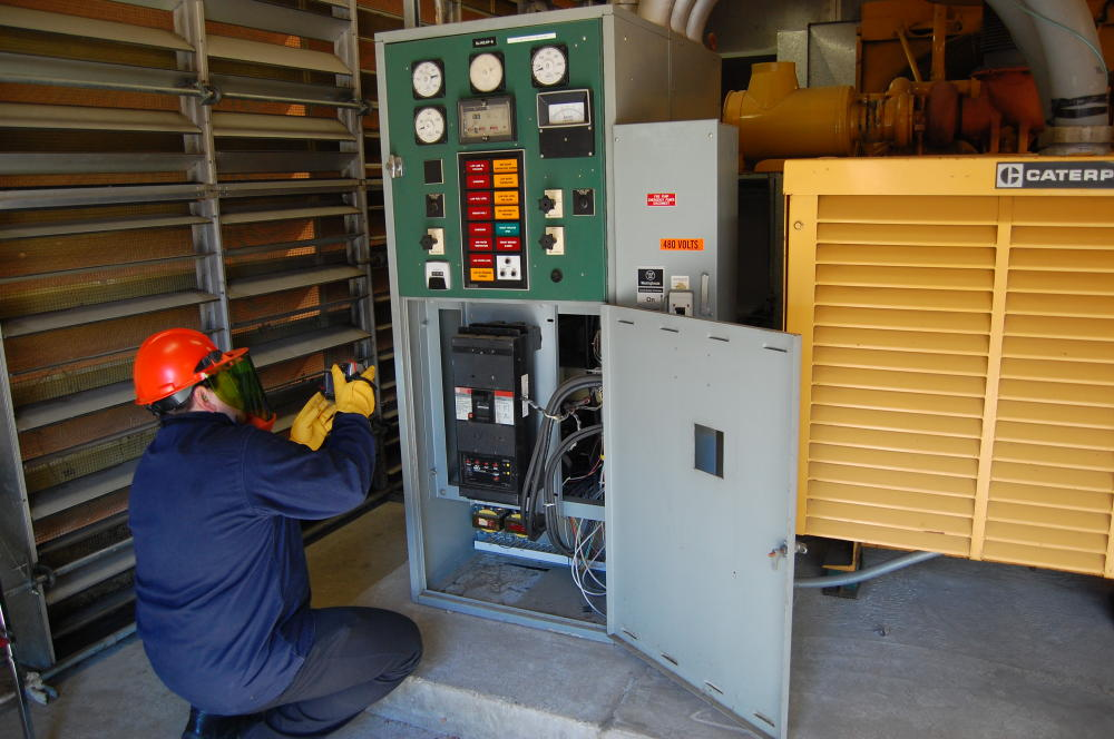 Worker checking a fuse box
